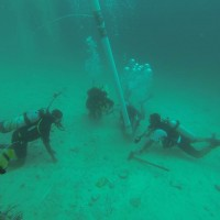 Underwater excavation in the Farasan Islands, offshore of Qumah, showing use of airlift with Faris Hamzi, Abdullah Al Haiti, Jumah Al Sadiq and Christin Mason (Photo: Garry Momber: 2014).